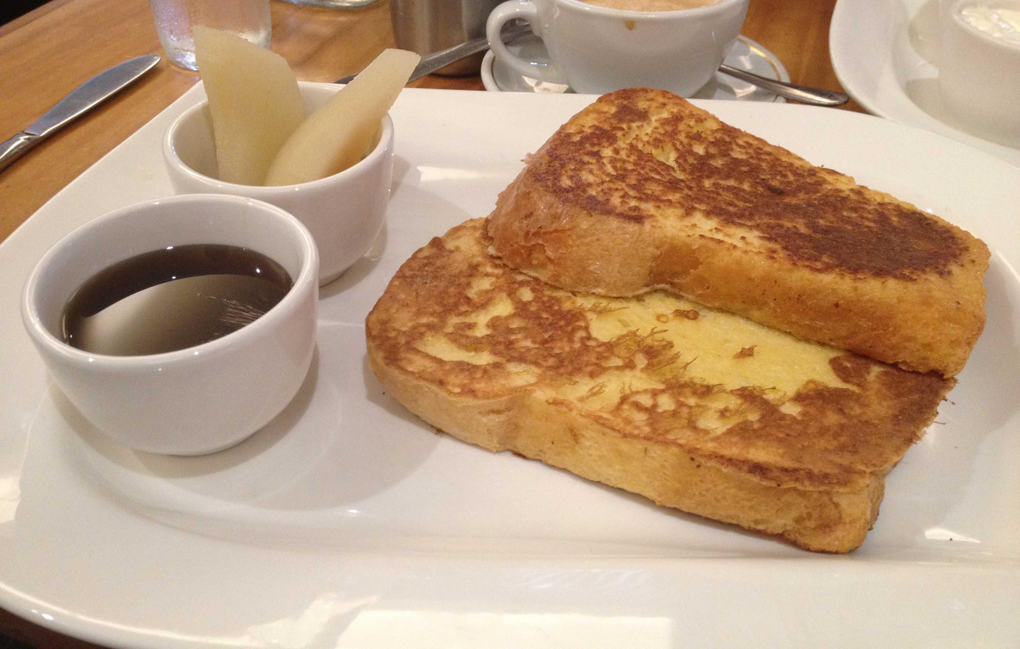 Brioche french toast with maple syrup and stewed pears